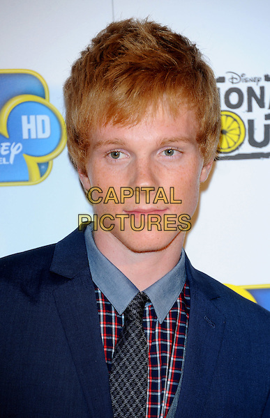 "Adam Hicks.""Lemonade Mouth"" special TV screening, BAFTA, Piccadilly, London, England..August 25th, 2011.headshot portrait blue check .CAP/CJ.©Chris Joseph/Capital Pictures."