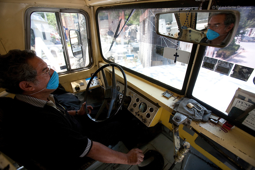 April 26, 2009 - Mexico City, Mexico - A funeral bus driver in Mexico city delivers passengers to their neighborhood after picking up the ashes of a child who died of the swine flu. Photo credit: Benedicte Desrus / Sipa Press