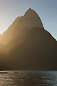 Milford Sound; Mitre Peak side-lit at sunset, Fiordland National Park, South Island, New Zealand