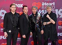 LOS ANGELES, CA. March 14, 2019: 5 Seconds of Summer, Ashton Irwin, Luke Hemmings, Calum Hood & Michael Clifford at the 2019 iHeartRadio Music Awards at the Microsoft Theatre.<br /> Picture: Paul Smith/Featureflash