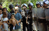 "Members of Brazil's Landless Rural Workers' Movement (MST) occupy  ranch at Belém-Brasilia Highway in Pará state northern of Brazil, on April 2001. The invasion is part of a celebration called ""Red April"" reminding the massacre in which 19 MST members were killed by the police in Eldorado dos Carajas.."