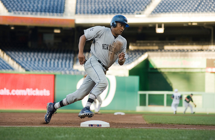 UNITED STATES - JULY 14:  Starting pitcher Rep. Cedric Richmond, D-La., rounds third during the 50th Annual Congressional Baseball Game at Nationals Park.  The Democrats prevailed over the Republicans by the score of 8-2.  (Photo By Tom Williams/Roll Call)