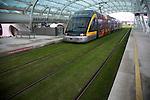 Metro train on grass tracks, Oporto airport station, Porto, Portugal