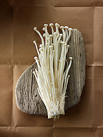 Fresh picked cultivated Enokitake, Enokidake or Enoki (Flammulina velutipes) commonly known as golden needle mushroom or lily mushroom, an edible mushroom.
