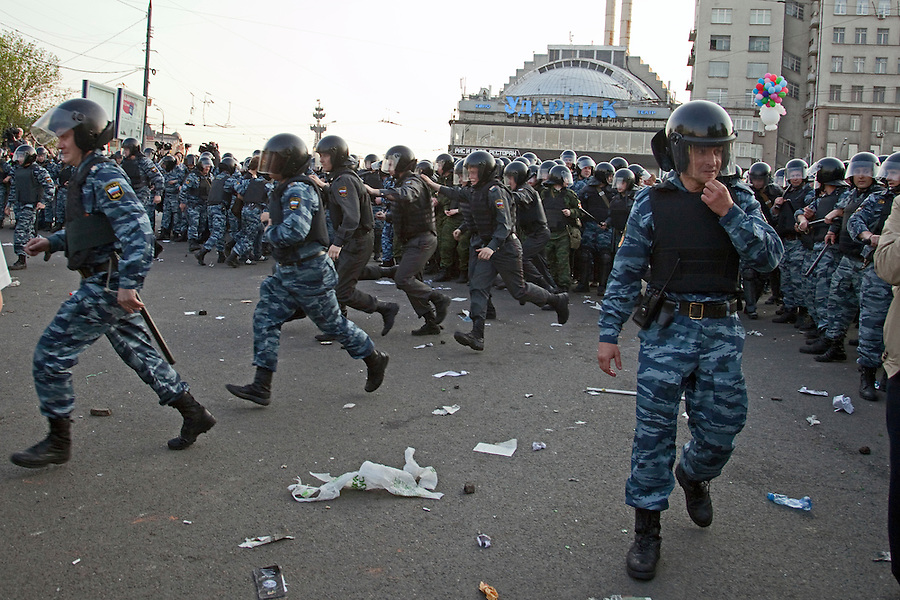 Moscow, Russia, 06/05/2012..Riot police charge protestors at opposition demonstration against Russian Presidential election results on the eve of Vladimir Putins inauguration as President.