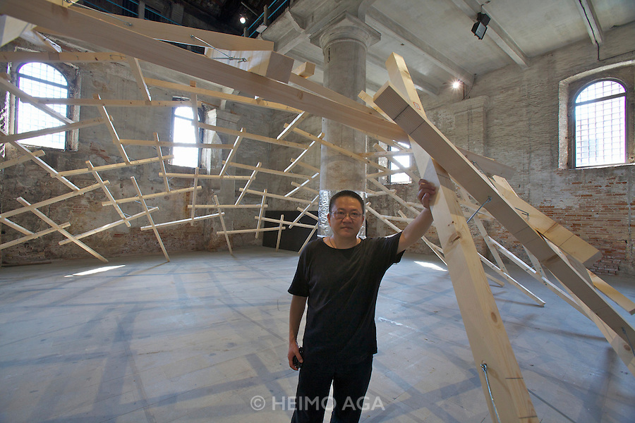 "12th Biennale of Architecture. Arsenale. Wang Shu with his installation (together with Lu Wenyu) ""The decay of a dome"", 2010."