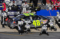 Apr 26, 2009; Talladega, AL, USA; NASCAR Sprint Cup Series driver Jimmie Johnson pits after crashing during the Aarons 499 at Talladega Superspeedway. Mandatory Credit: Mark J. Rebilas-