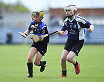 Susan Mc Grath of Kilkee/Kilbaha in action against Ciara Nolan of Bridgetown during their Schools Division 6 final at Cusack Park. Photograph by John Kelly