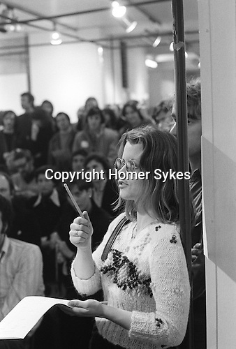 "The Photographers Gallery Great Newport Street London 1971. ""Co Optic"" Christmas Print Auction. Catherine Saunders, and photographer Colin Curwood behind her."