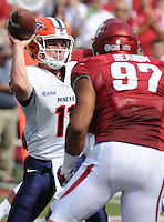 NWA Democrat-Gazette/ANDY SHUPE<br /> Arkansas' Tevin Beanum (97) pursues University of Texas at El Paso's Mack Leftwich Saturday, Sept. 5, 2015, during the second quarter of play in Razorback Stadium in Fayetteville. Visit nwadg.com/photos to see more from the game.