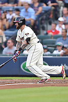 Atlanta Braves left fielder Jonny Gomes (7) swings at a pitch during a game against the Chicago Cubs on July 18, 2015 in Atlanta, Georgia. The Cubs defeated the Braves 4-0. (Tony Farlow/Four Seam Images)