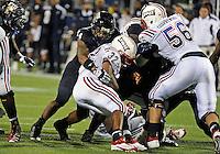 Florida International University football player linebacker Winston Fraser (34) plays against the Florida Atlantic University on November 12, 2011 at Miami, Florida. FIU won the game 41-7. .