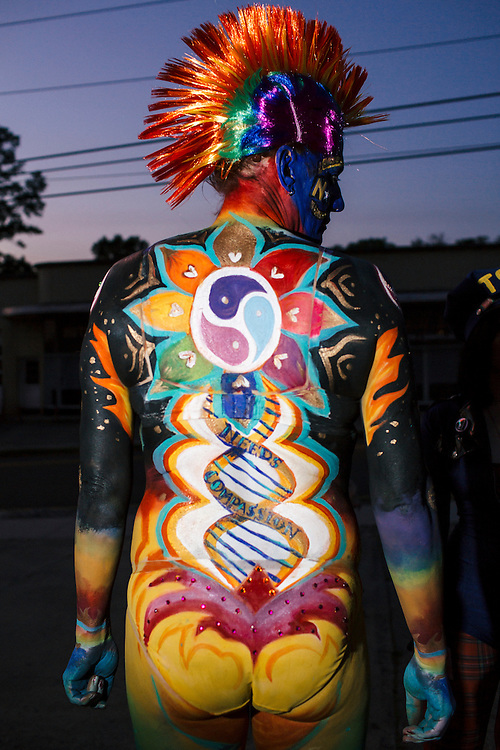 Durham, North Carolina - Sunday May 15, 2016 - Juno Krahn displays the body paint by Molly Chopin and MaryBethPanagos with imagery designed to bring awareness to transgender rights. Against Me! kept their scheduled tour date in Durham and used the show as a platform to protest North Carolina House Bill 2.