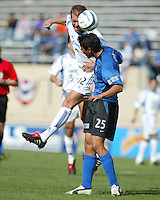 24 October 2004: Brian Ching of Earthquakes battles for the ball in the air with Jimmy Conrad of Wizards at Spartan Stadium in San Jose, California.   Earthquakes defeated Wizards, 2-0.  Credit: Michael Pimentel / ISI