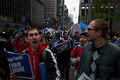 New York, New York<br /> May 1, 2012<br /> <br /> May Day in Manhattan as demonstrators come out in strength to mark the day and support the &quot;Occupy&quot; movement.<br /> <br /> Protesters march up mid-town 6th Avenue to demonstrate in front of a hedge fund company.