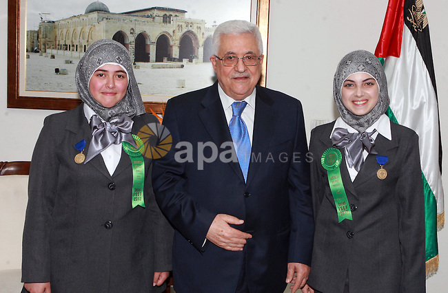 Palestinian President Mahmoud Abbas (Abu Mazen) meets with the two students, participat in contest International Science and Technology in ther West Bank city of Ramallah on May 24, 2012. Photo by Thaer Ganaim