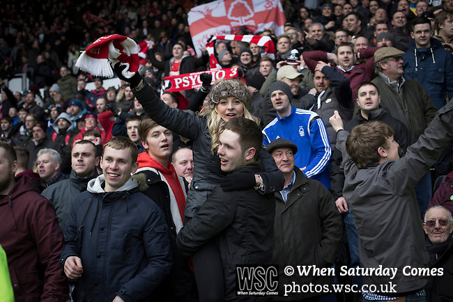 Derby County 1 Nottingham Forest 2, 17/01/2015. iPro Stadium, Championship. Visiting supporters celebrating after Ben Osborn's winning goal in injury time during the second-half of Derby Country's Championship match against Nottingham Forest at the iPro Stadium, Derby. The match was won by the visitors by 2 goals to 1, watched by a derby-day crowd of 32,705. The stadium, opened in 1997, was formerly known as Pride Park. Photo by Colin McPherson.