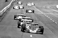 HAMPTON, GA - APRIL 22: Lee Kunzman (#21 Parnelli VPJ6C/Cosworth TC) ahead of Rick Mears (#9 Penske/Cosworth TC) and others during the Gould Twin Dixie 125 event on April 22, 1979, at Atlanta International Raceway near Hampton, Georgia.