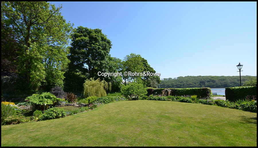BNPS.co.uk (01202 558833)<br /> Pic: Rohrs&Rowe/BNPS<br /> <br /> Stunning views...<br /> <br /> Idyllic riverside vicarage in the heart of Cornwall...<br /> <br /> A former vicarage that has been transformed into a stunning riverside home is now on the market for £1.895m.<br /> <br /> The Old Vicarage in the picturesque hamlet of St Clement, Cornwall, is right on the banks of the Tresillian River, a tributary of the River Fal.<br /> <br /> The seven-bedroom property has spectacular views of the river and estate agents Rohrs & Rowe say although it is just a mile from the cathedral city of Truro, the home feels like it's in the heart of the countryside.<br /> <br /> The current owners have run the property, which dates back to the 1500s, as a guesthouse, but it could easily be sold to someone looking for a lifestyle change or run as a business.