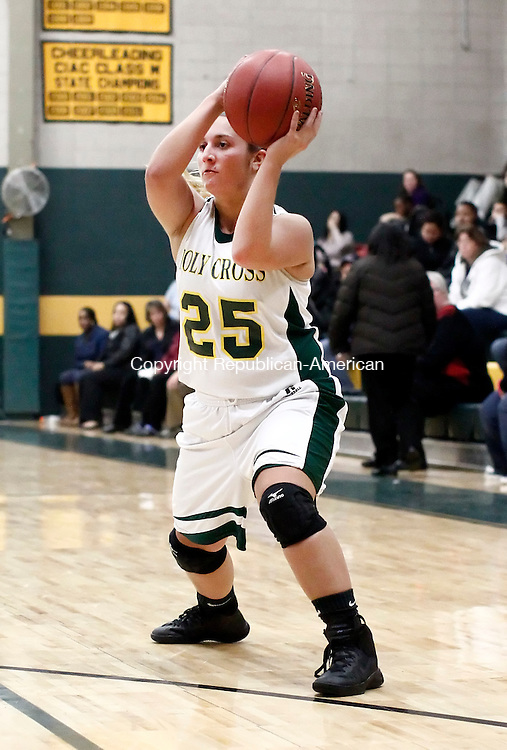 Waterbury, CT- 16 December 2014-121614CM09-   Holy Cross' Casey DiZinno  looks for an open teammate during their NVL matchup against Kennedy on Tuesday.   Christopher Massa Republican-American
