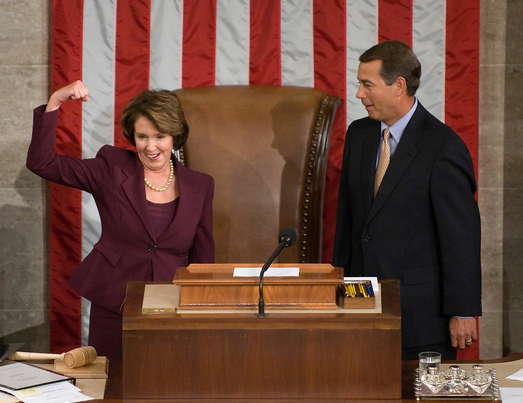 Speaker of the House Nancy Pelosi receives the gavel from Minority Leader John Boehner on the House Floor after being elected Speaker on Thursday, Jan. 4, 2007.