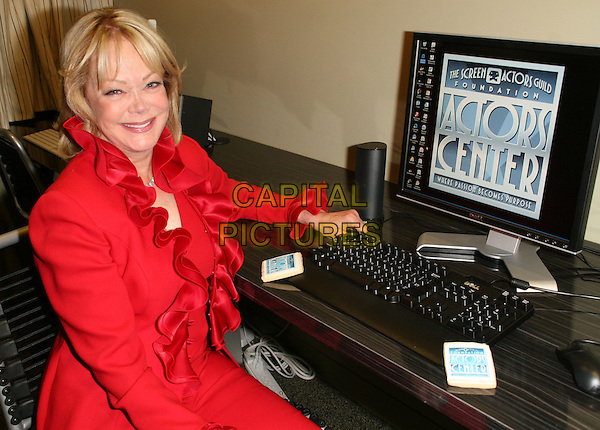 CANDY SPELLING .Screen Actors Guild foundation open its 1st actor in center Los Angeles in Memory of Aaron Spelling, held at SAG Los Angeles building, Los Angeles, California, USA, 24 July 2008..half length red frill neck ruffle jacket computer sitting .CAP/ADM/FS.©Faye Sadou/Admedia/Capital Pictures