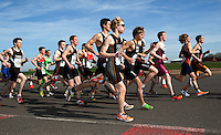 25 MAR 2012 - LOUGHBOROUGH, GBR - Junior Men and Elite Men mix at the start of their race at the 2012 British Elite Duathlon Championship race at Prestwold Hall Airfield in Prestwold near Loughborough, Great Britain (PHOTO (C) 2012 NIGEL FARROW)