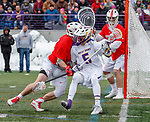 University at Albany Men's Lacrosse defeats Cornell 11-9 on Mar 4 at Casey Stadium.   Connor Fields (#5) finds difficult going through defender Jake Pulver (#34).