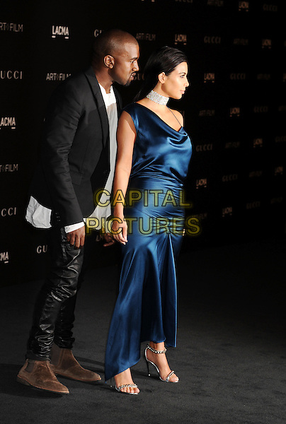 LOS ANGELES, CA - NOVEMBER 01: Recording artist Kanye West (L) and TV personality Kim Kardashian attend the 2014 LACMA Art + Film Gala honoring Barbara Kruger and Quentin Tarantino presented by Gucci at LACMA on November 1, 2014 in Los Angeles, California.<br /> CAP/ROT/TM<br /> &copy;Tony Michaels/Roth Stock/Capital Pictures