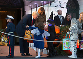 United States President Donald J. Trump and First Lady Melania Trump give out treats during a Halloween event at The White House in Washington, DC, October 30, 2017. Credit: Chris Kleponis / CNP
