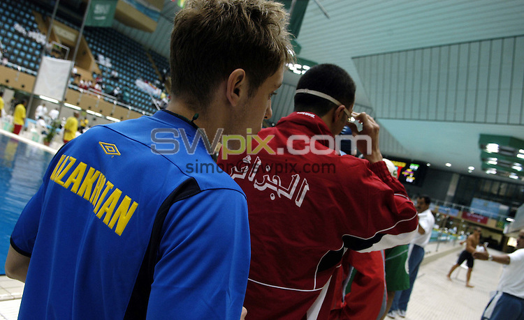 Pix: Simon Wilkinson/SWpix.com. 1st Islamic Solidarity Games 2005. The Kingdom of Saudi Arabia. Jeddah, Madina, Mecca and Taif. Swimming, Jeddah Olympic Pool...copyright picture>>simon Wilkinson>>07811 267 706>>..Swimmers get ready to race