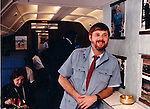 Ron Bennett Photojournalist on Air Force One UPI  White House correspondent Helen Thomas is in background,