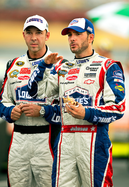 Race car driver Jimmie Johnson and crew chief Chad Knaus, of the no. 48 Lowe's Chevy Monte Carlo, talk strategy while waiting out the rain at the Lowe's Motor Speedway, in Concord, NC, during the 2009 Coca-Cola Classic 600 NASCAR race. Driver David Reutimann won his first Cup race during the rain-shortened event, held May 25, 2009. NASCAR's longest scheduled race went only 227 laps, or 340.5 miles, before officials ended it because of rain. The 2009 race was the 50th running of the Coca-Cola 600. Ryan Newman and Robby Gordon finished second and third respectively.