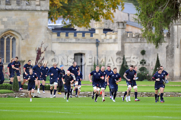 The Bath squad take to the field. Bath Rugby training session on October 17, 2013 at Farleigh House in Bath, England. Photo by: Patrick Khachfe/Onside Images