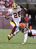 Landover, MD - October 19, 2008 -- Washington Redskins running back Clinton Portis (26) eludes Cleveland Browns defensive back Brandon McDonald (22) in the third quarter at FedEx Field in Landover, Maryland on Sunday, October 19, 2008.  Portis ran for 175 yards on 27 carries in the Redskins 14 - 11 victory..Credit: Ron Sachs / CNP