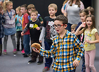 NWA Democrat-Gazette/BEN GOFF @NWABENGOFF<br /> Judah Libertini, 8, joins other kindergarten through 2nd grade students in a game of 'hot potato' Thursday, Feb. 22, 2018, during the biweekly 'social day' meeting of the Social Homeschoolers Network of Northwest Arkansas at the First Baptist Church of Rogers Olive Street Campus.