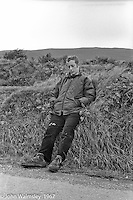 """John Walmsley, then a photography student at Guildford School of Art, on a hitching and camping trip around Southern Ireland, on the road near Dunquin (in Gaelic, Dún Chaoin, meaning """"Caon's stronghold""""), on the tip of the Dingle Peninsula, County Kerry, Ireland.  1971."""