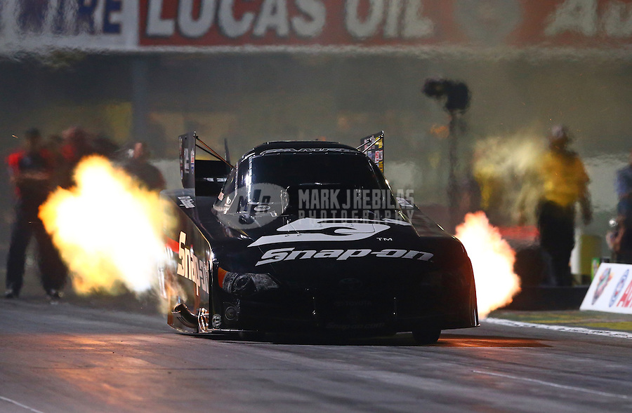 Nov 14, 2014; Pomona, CA, USA; NHRA funny car driver Cruz Pedregon during qualifying for the Auto Club Finals at Auto Club Raceway at Pomona. Mandatory Credit: Mark J. Rebilas-USA TODAY Sports