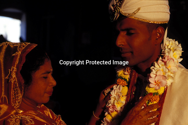 dipphin00070 .Religion. Hindu A mother prepares his son for a Hindu wedding in their house in Grand Bayon July 2, 2003, in Grand Bay on Mauritius. The island is mainly Hindu but also Christian and Muslim. The island, located in the Indian Ocean, is a popular place for tourists. .©Per-Anders Pettersson/ iAfrika Photos