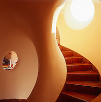 A curved staircase winds its way up through the property