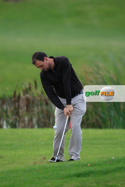 James Quinlivan (Mullingar G.C) on the 18th during Round 2 of The Cassidy Golf 103rd Irish PGA Championship in Roganstown Golf Club on Friday 11th October 2013.<br /> Picture:  Thos Caffrey / www.golffile.ie