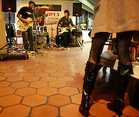 Fans look on as San Diego trio Virto launch into their first set outside clothing store Infectious Threads in Ocean Beach, Saturday January 26, 2008.
