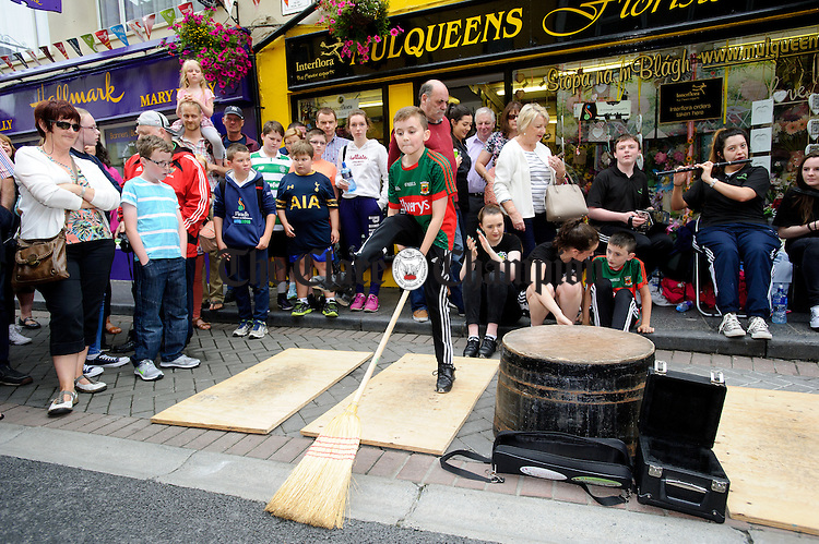 Mayo's Steven Monaghan dancing on O Connell street during Fleadh Cheoil na hEireann in Ennis. Photograph by John Kelly.