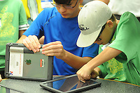 From left, Aidan Rosa, 12, and Luke Lindsey, 10 tighten cases around their iPads after the Neshaminy Maple Point Middle School students arrived back from the Apple Store Monday August 17, 2015 in Middletown, Pennsylvania. The students will serve as IT ambassadors while helping their classmates and teachers navigate iPad issues this school year. (Photo by William Thomas Cain)