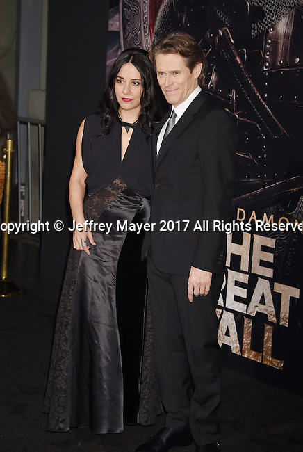 HOLLYWOOD, CA - FEBRUARY 15: Actor Willem Dafoe (R) and wife/director Giada Colagrande arrive at the premiere of Universal Pictures' 'The Great Wall' at TCL Chinese Theatre IMAX on February 15, 2017 in Hollywood, California.