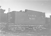 End side view of water car #W488 - tender body - at Alamosa.<br /> D&amp;RGW  Alamosa, CO  Taken by Richardson, Robert W. - 12/12/1948