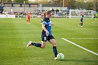 Kansas City, Mo. - Saturday April 23, 2016: FC Kansas City midfielder Heather O'Reilly (9) kicks the ball during a match against Portland Thorns FC at Swope Soccer Village. The match ended in a 1-1 draw.