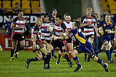 Sherwin Stowers is taken by Chris Noakes. New Zealand Cup rugby game played at Mt Smart Stadium, Auckland, between Counties Manukau Steelers & Otago on Thursday August 21st 2008..Otago won 22 - 8 after leading 12 - 8 at halftime.