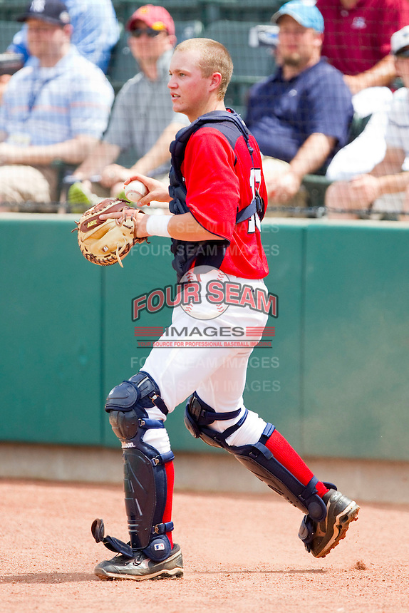 Catcher AJ Kennedy #10 of Babe Ruth on defense against PONY at the 2011 Tournament of Stars at the USA Baseball National Training Center on June 25, 2011 in Cary, North Carolina.  Babe Ruth defeated PONY by the score of 10-9. (Brian Westerholt/Four Seam Images)