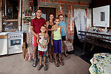 August 2012 - Serbia. Junkovac village - Municipality of Lazarevac. Stojanovi? family arrived in 1999 from Sma? - Kosovo. Sladjana Stojanovi? (mother):?We were in a good terms with everybody, there were no signs that we had to leave our home. My uncle was kidnapped by the KLA and we still don't know what happened to him. We were afraid that the same thing could happen to us. So we got in the car and joined the queue of displaced persons. We thought we would be back soon, so we didn't bring a lot of things, just some clothes. I was pregnant when we fled. As we were going through the Kosovo, we were scared because we heard gunshots around us.?Tamara (younger daughter) dreams of having her own room, and she wants to become trader. Ivana (older daughter) has the same wishes. Cvetko (son) do not mind sharing a room with parents, and he would like to have a cow.